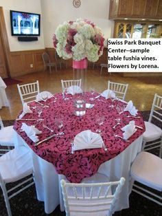 Swiss Park Banquet Center, Whittier CA--Pacakge A full-length white tablecloths, white Chiavaris, white fan folded napkins and fuschia/black vine printed overlay. Centerpieces with hydrangeas and orchids provided by Flowers By Lorena in Chino, CA Tablecloths, Hydrangeas, Banquet, Overlay, Orchids, Vines, Wedding Flowers, Napkins, Centerpieces