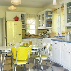 pictures of kitchens with yellow walls, white cabinets and blue countertops | Tuesday's Favorite Pins