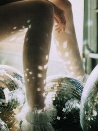 Mirror balls....my favourite accessory! We should so involve these.
