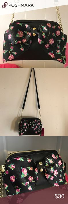 NWT Betsey Johnson Cross Body Bag Never used, new with tags black Betsey Johnson cross body bag with rose buds print bow on the front! Sturdy hardware and a spacious inside with an inner pocket. Betsey Johnson Bags Crossbody Bags