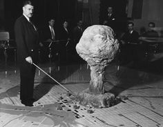 Using an atomic mushroom cloud model, Lt. Col. W. Arthur Croteau, head of Canada's Civil Defense Training Centre demonstrates the effect of an atomic bomb on the nation's capital . 1952.