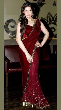 Maroon Velvet and Net Saree has Mirror Work. Ideal Maroon Sleeve Less Blouse Saree for Bridal is Velvet and Net Saree worn by Zareen Khan. This Mirror Work Saree is Bridal,Ring Ceremony wear. Available in alternate colors on order. It is available in all sizes.        Color : Maroon    Fabric Details    Pallu : Velvet Work Hand Work    Skirt : Soft Net with zardosi work    Blouse : Velvet ( Semi stitched )    Occasion : Bridal Party wear    Item Type : Saree    Customization : Made To…