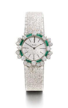 Lady's 18K White Gold Emerald and Diamond-set Bracelet Watch, Piaget