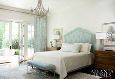 beautiful bedroom with aqua accents