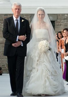 Chelsea Clinton as her Father walks her down the aisle. Americans watched this beautiful young woman enter the White House as a girl and leave the White House as a woman.