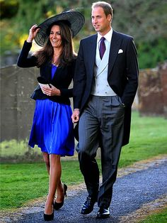 """WEDDING DATE  A dashing William and beaming Kate make a rare public appearance together at a friend's Oct. 23 nuptials in Northleach, Gloucestershire, igniting a new round of royal wedding forecasts for the beaming couple. """"She looked so happy,"""" an observer tells PEOPLE."""