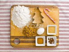 overhead view of cake ingredient on kitchen worktop. - Overhead view of cake ingredient with cookie cutter and candy cane on kitchen worktop.