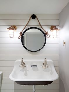 Nautical Changing room for Pool House with white ship-lap and fun No diving floor tile. Kohler Double sink painted black. Restoration hardware brass sconces and round mirror. Fun Bathroom for Kids and Adults. Classic design by SHOPHOUSE Interior Design. www.shophousedesign.com