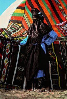 Africa | Tuareg warrior stands guard outside the groom's desert tent. Niger | ©Rosemary Sheel
