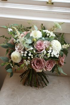 Bouquet of amnesia roses, mentha roses, dahlia, bouvardia, waxflower, astilbe, amme, jasmine and eucalyptus...