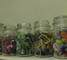 I use empty Yankee Candle bottles to store my buttons, buckles and embellishments - great because you can see what's in each jar.