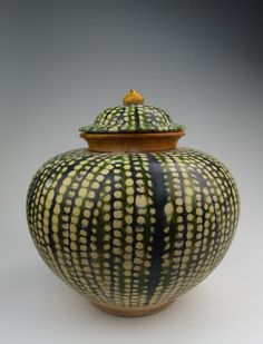 Chinese Tang Dynasty tri-colored pottery lidded pot.