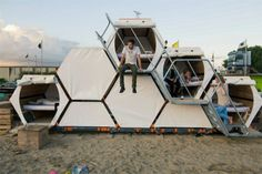 honeycomb concert accommodations would work for homeless populations as well. You could get 1-2 people per pod. There's room inside for a single bed, desk, cubbies for storage, under bed storage etc. make them with an exterior of plastic, like a SIPS panel, for insulation. They could easily create an entire community with central bathing facilities. Easy enough to heat/cool by installing a small a/c and heating unit in the back of each pod, or by central heat/cooling via vents.