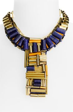 Love this lapis and gold Tory Burch collar necklace. Again, would look amazing with a simple white top or white maxi dress during the summer!