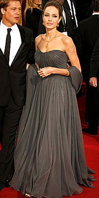 f1d3ee9ab4fb Angelina Jolie balances out her inverted triangle shape by choosing a gown  with a fuller skirt