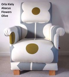 It is then upholstered entirely with this lovely Orla Kiely Multi Stem fabric, and has solid wooden feet. Retro Armchair, Retro Fabric, Orla Kiely, Chair Fabric, Fabric Flowers, Mustard, House Styles, Grey, Furniture