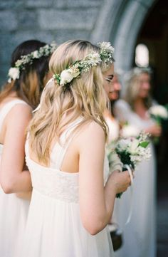 Crown like this with baby's breath, greenery and white and purple (blue, fushia) flowers.  Not too wide but flowers to be same thickness/fullness all around.