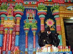 """Perumal temple looks grand in the gateway (entrance) to the shrine where the statues of the """"dwarabalaka""""( the guard-statue) are kept."""