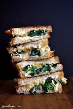 Spinach and Artichoke Grilled Cheese! cook the spinach in water in the skillet, then add the artichoke hearts, then toast the bread and make a sandwich