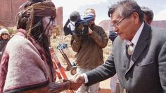 Navajo leaders give a blanket to Johnny Depp as a gift