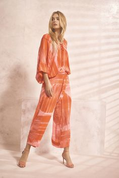 Escape your winter blues wearing a colorful and chic outfit from Josie Natori. Shop now at natori.com