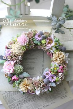 This unique pine cone wreath in shades of blue, gray, pink and white would make a lovely house-warming gift or brighten up your own home. Each pine cone is hand painted and wired and measures x Sprayed with a water-resistant acrylic spray, this Pine Cone Art, Pine Cone Crafts, Wreath Crafts, Diy Wreath, Door Wreaths, Pine Cones, Couronne Diy, Christmas Wreaths, Christmas Crafts
