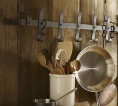 Love the wood wall.. Pot Rack.