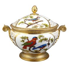 French Porcelain Covered Soup Tureen  19th Century  Painted with exotic birds and inscribed on the base Le merle des Philipinnes le mignon and Le liri cricolror le quintrimoir. Length 11 1/2 inches (29.2 cm).