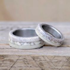 This wedding band set includes a men and womens band with Elk Antler and Artificial Ivory divided by Crushed Elk Ivory Teeth. This listing is For TWO matching wedding bands. If you have any questions please message us.  Please send us a message with your desired Ring Size.  We love to hear your ideas. Please message us with custom ring ideas, or if you want anything special included/changed in this ring. Remember that we do different metals for the inner band. This ring can come with eit...