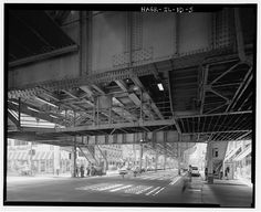 5.  VIEW TO SOUTH. GROUND LEVEL. SUBSTRUCTURE AND FRAMING MEMBERS UNDERSIDE MEZZANINE CROSSOVER BRIDGE. - Union Elevated Railroad, Randolph-Wabash Avenue Station, Randolph Street & Wabash Avenue, Chicago, Cook County, IL