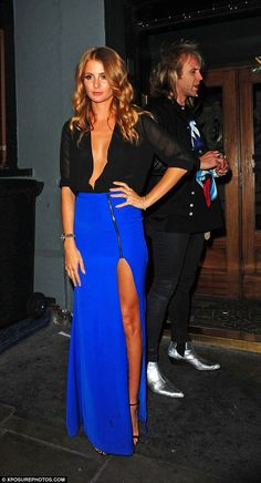 Millie Mackintosh.. black plunging blouse and thigh split maxi skirt, both from her Millie Mackintosh label..
