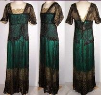 Several views of a beautiful emerald green silk and black lace dress.  Trimmed with gold lace at the neckline.