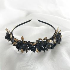 The Annabelle Headpiece showcases Nikki Witt's signature handmade flowers. Black four-petalled flowers bloom atop golden leaves for an edgy yet. Golden Leaves, Handmade Flowers, Headpieces, Black, Jewelry, Fashion, Moda, Fascinators, Black People
