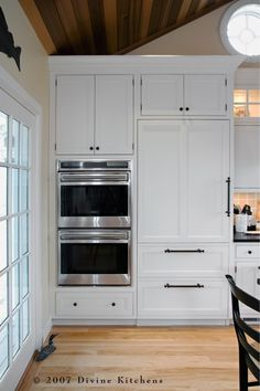Nice combination of handles and knobs.  Sub-Zero Integrated Refrigerator and Wolf L Series Double Ovens