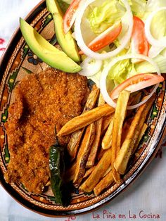 Beef, chicken and pork can be used for this delicious recipe. In my family, cracker meal was traditionally used to bread the thin sliced beef, but breadcrumbs work well too. Many plated mila Milanesa Recipe, Thin Sliced Beef, Traditional Mexican Dishes, Spicy Salsa, Mexican Food Recipes, Ethnic Recipes, Easy Salads, Steak Recipes, Breakfast