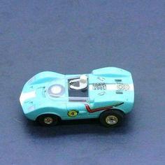 Vintage Unique Aqua Sports Car #4 HO Slot Car w Spare In Front RUNS GREAT Lot 2