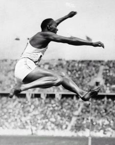 Jesse Owens takes gold in the long jump, Berlin 1936 (Wikimedia Commons/German Federal Archive)
