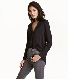 Check this out! V-neck blouse in an airy woven fabric with long sleeves, wide, gently flared, buttoned cuffs, and a rounded hem with slits at sides. - Visit hm.com to see more.