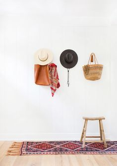 Gorgeous entryway/mud room with hanging hats and bags
