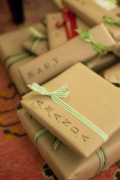 This is the smartest gift wrapping ever - brown paper=cheap & easy, stamped on names make anything look more impressive & ribbon is always fun.