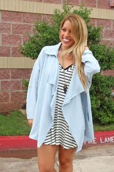 Oversized lightweight trench. This super trendy lightweight chambray style trench is very cute and very trendy. We love layering it over a striped Piko top or s