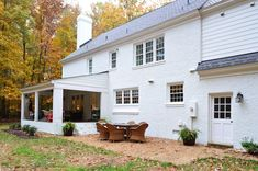 House Painted brick from the back showing two exterior doors white before paint White Wash Brick Exterior, White Exterior Houses, Exterior House Colors, Exterior Doors, Ranch Exterior, Exterior Paint, Entry Doors, Garage Doors, Painted Brick Exteriors