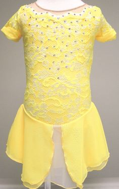 Inspired by Belle from Disneys Beauty and the Beast, this elegant figure skating dress brings out the character of the music.