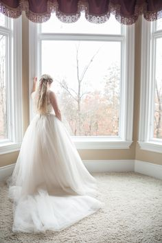 Bridal suit at the Lakeside Inn. Windows overlook a wooded area and private cove on Tellico Lake. Photography by Star Noir Studios.