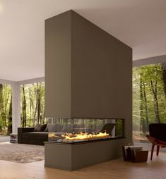 Modern living room with a fireplace, which divides the room. Nice!