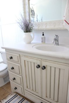 french farmhouse bathroom - vanity with middle doors and side drawers, want in double vanity style