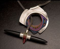 """Necklace by Nena G. Potts """"Toggle Target"""" Sterling silver, black onyx bullets with Prismacolor"""