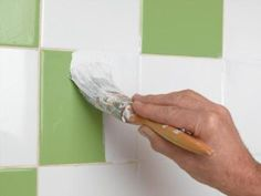 PAINT OLD TILES WITH TILE PAINT:  Tile paint is a paint that has been designed for the specific purpose of decorating or changing the colour of any tiled surface, except for tiled floors.