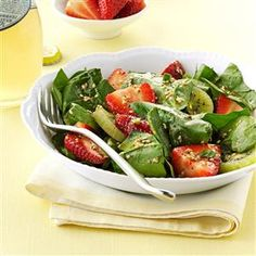 Kiwi-Strawberry Spinach Salad Recipe -This pretty salad is always a hit when I serve it! The recipe came from a cookbook, but I personalized it. Sometimes just a small change in ingredients can create a big difference. —Laura Pounds, Andover, Kansas