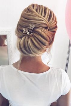 Messy and Trendy Updo with Flowers picture2